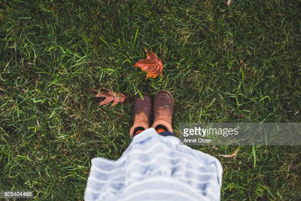 Little Girl Boots Where She Stands in The Fall