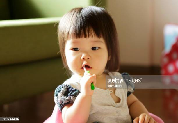 Little girl brushing a teeth