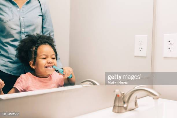 """little girl brushing her teeth - """"marilyn nieves"""" stock pictures, royalty-free photos & images"""