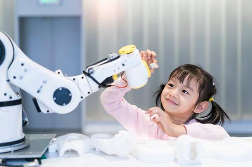little Girl Building Robotic Arm At School 1067038300