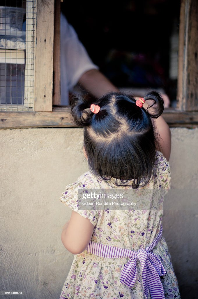 Little girl buying at the store : Stock Photo