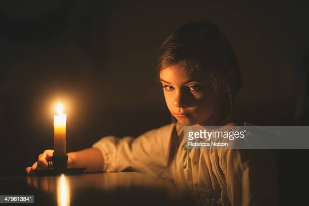 Little girl by candlelight