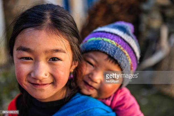 Little girl carrying baby on the back, Solukhumbu, Nepal