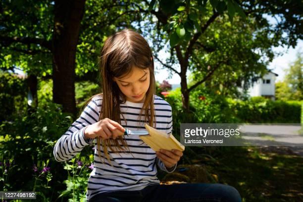 little girl carving wood - larissa veronesi stock-fotos und bilder