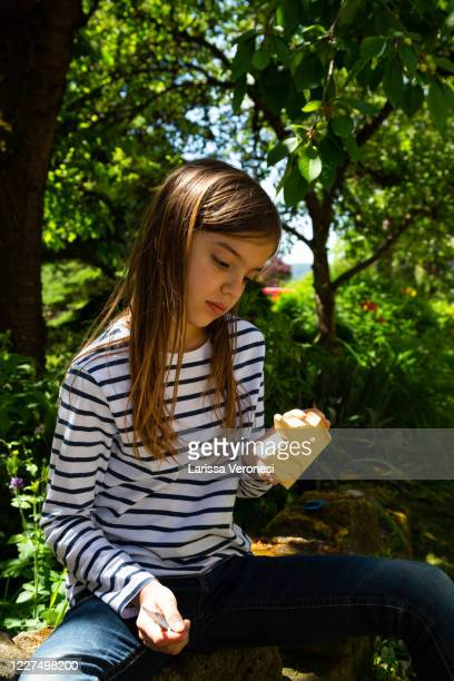 little girl carving wood - larissa veronesi stock pictures, royalty-free photos & images