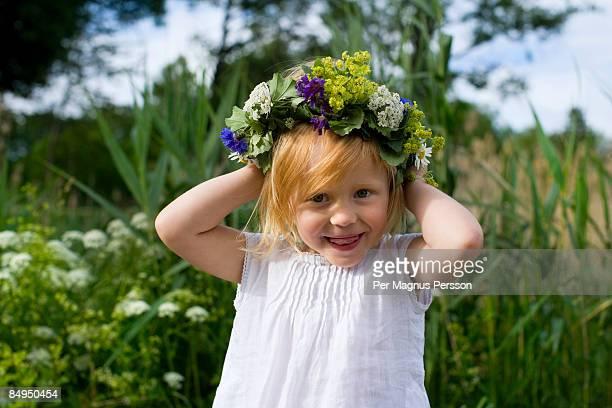a little girl celebrating midsummer sweden. - midsummer sweden stock pictures, royalty-free photos & images
