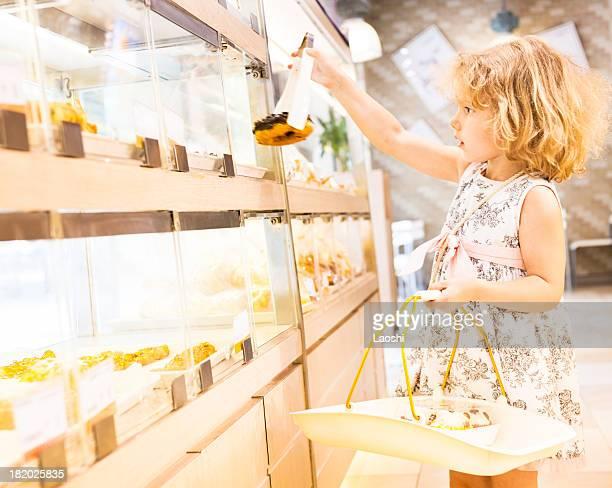 Little girl checks cake