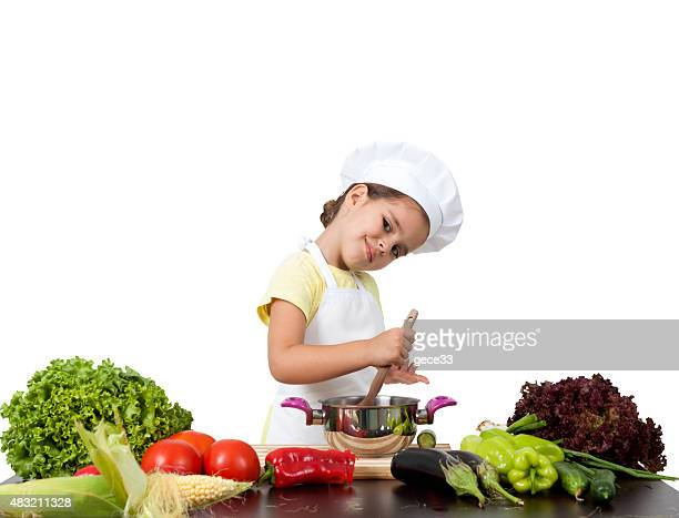 Little girl chef preparing cook