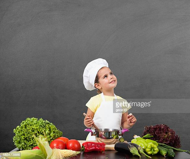Little Girl Chef Thinking of  on Blackboard