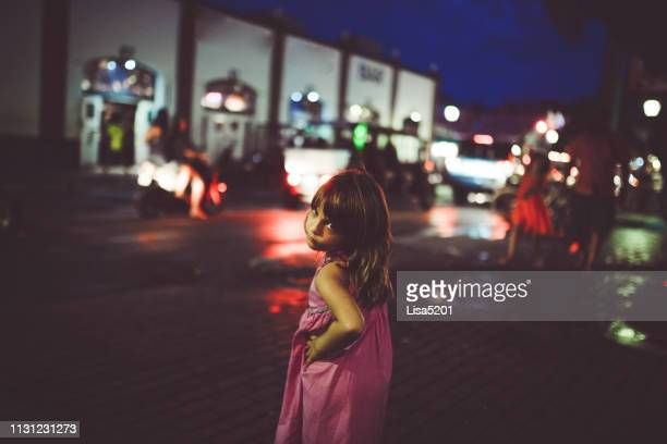 little girl, city at night, dark and alone, sassy kid - duval street stock pictures, royalty-free photos & images