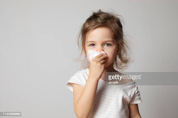 little girl cleaning her nose - cold virus stock pictures, royalty-free photos & images
