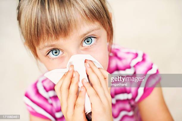 little girl cleaning nose - handkerchief stock photos and pictures