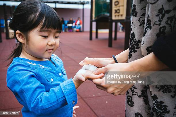 little girl cleansing hands with sanitizer - hand sanitizer stock pictures, royalty-free photos & images