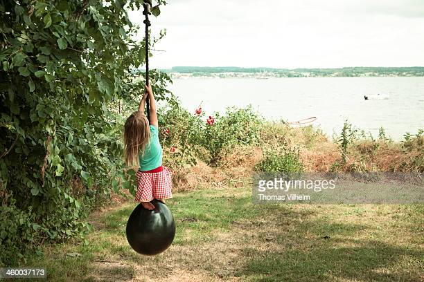 little girl climbing a rope - funen stock pictures, royalty-free photos & images