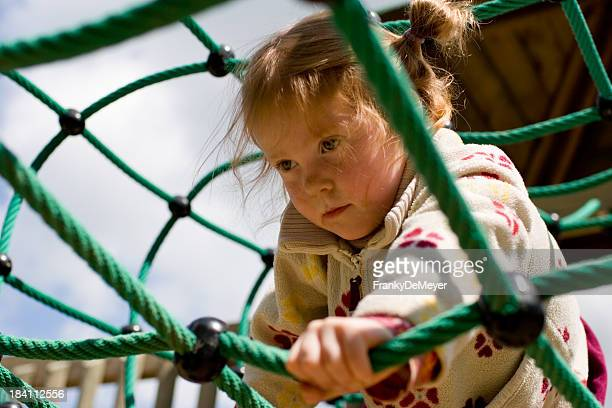 Little girl, climbing at the playground