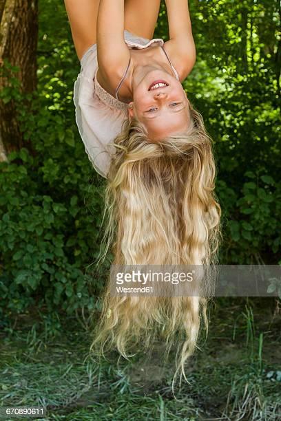 Little girl climbing on a tree