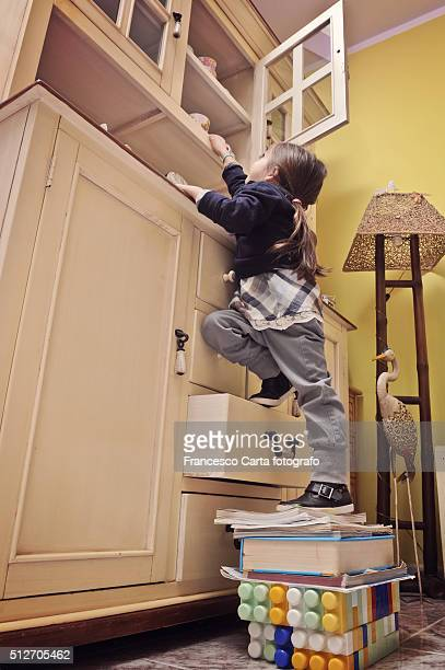 little girl climbing - danger stock photos and pictures