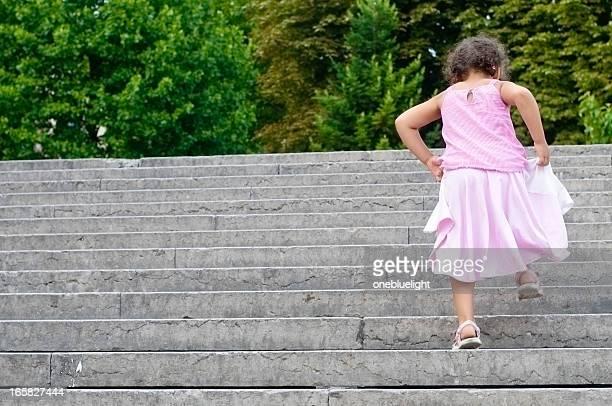 Little Girl (5-6) Climbing Stairs Outdoors, Horizontal