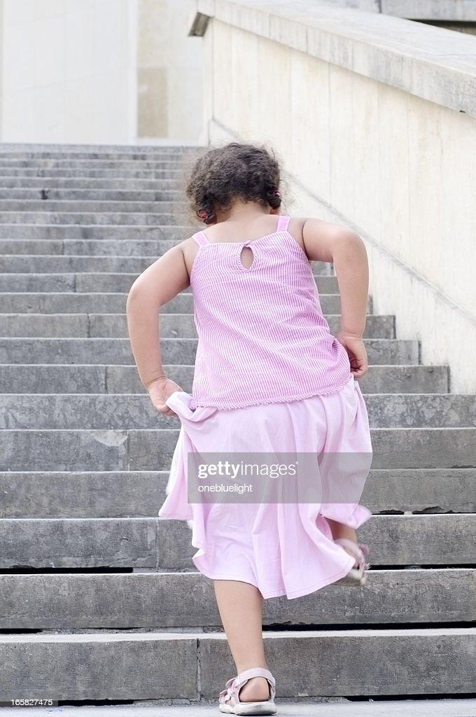 Little Girl (5-6) Climbing Stairs Outdoors, Horizontal : Stock Photo