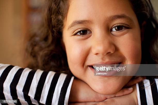 Little Girl Close Up with dark skin and brown hair