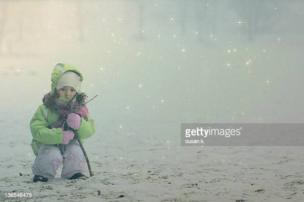 Little girl collecting firewood for winter