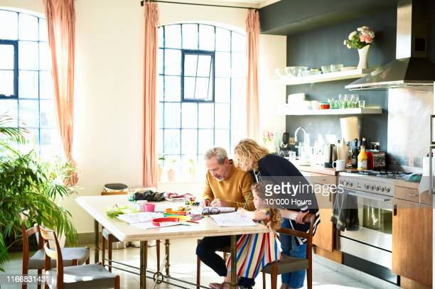 little girl colouring in at table in grandparents' home - art and craft stock pictures, royalty-free photos & images