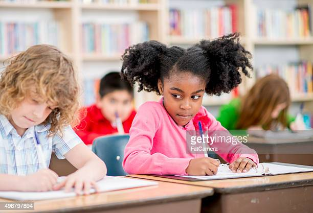Little Girl Copying Answers