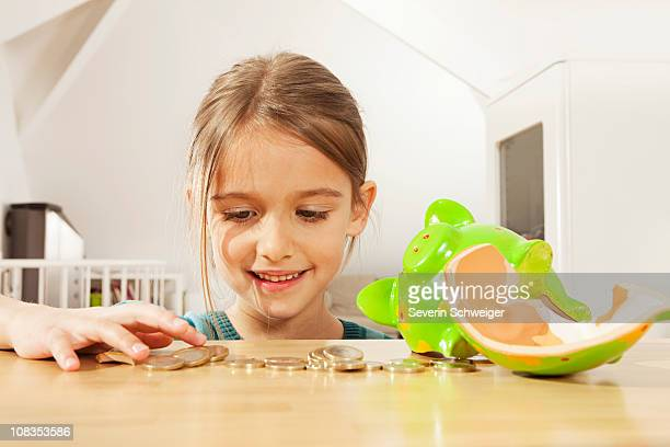 Little girl counting money