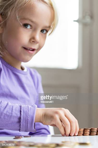Little girl counting pocket money