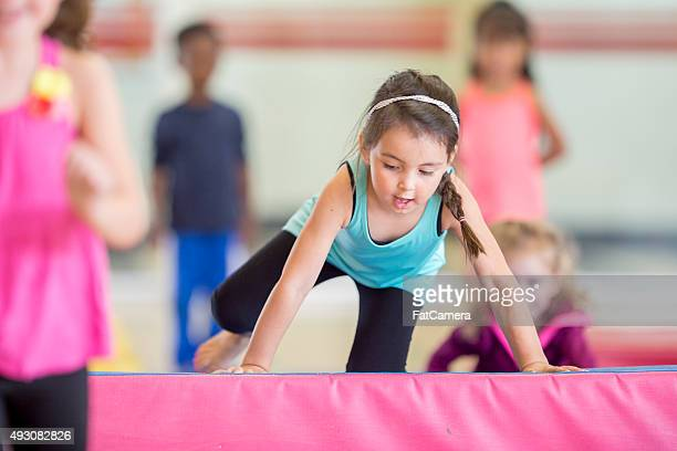 Little Girl Crawling Over the Mat