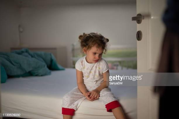 little girl crying in bedroom - penalty stock pictures, royalty-free photos & images