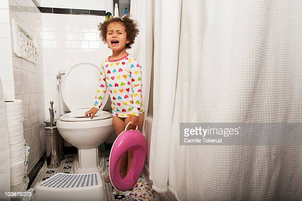 Little girl crying in the bathroom
