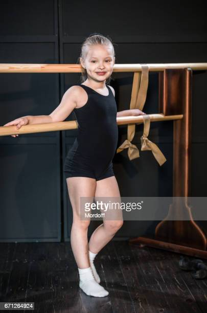 little girl dancer next to choreographic machine - little russian girls stock photos and pictures