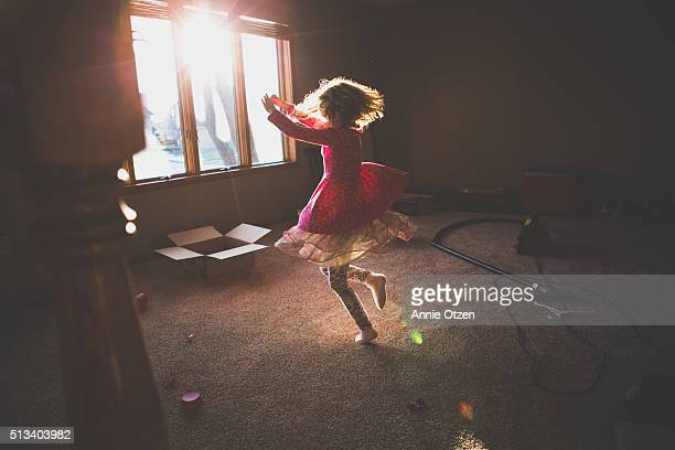 Little Girl Dancing in A sunny Room