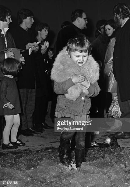 A little girl dancing in jelly during the 'Psychedelic Sale At The Roundhouse' an event organized by the Arts Lab at the Roundhouse in Chalk Farm...