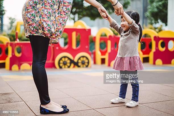 Little girl dancing with mom joyfully