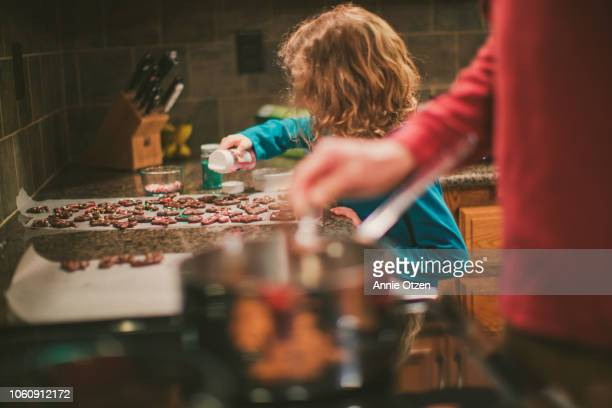 Little Girl decorates Chocolate covered pretzels