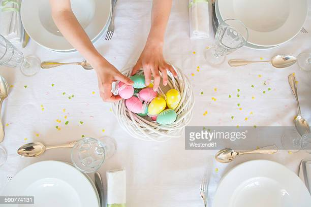 little girl decorating dining table with easter eggs - easter egg stock pictures, royalty-free photos & images