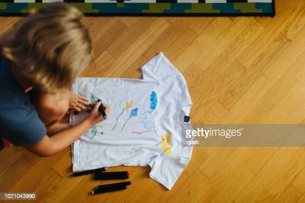 little girl decorating t-shirt - felt tip pen stock pictures, royalty-free photos & images
