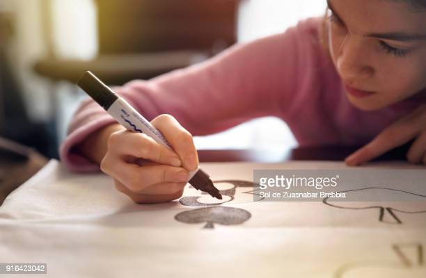 little girl doing crafts on a table at home with beautiful light - felt tip pen stock pictures, royalty-free photos & images