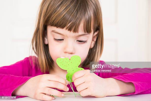 little girl doing embroidery at home