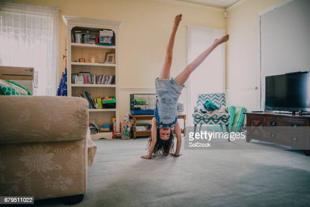 Little Girl Doing Gymnastics at Home