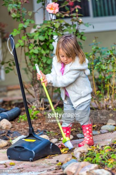 little girl doing her chores - sweeping stock pictures, royalty-free photos & images