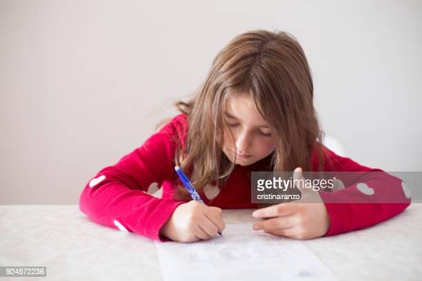Little girl doing homework at home