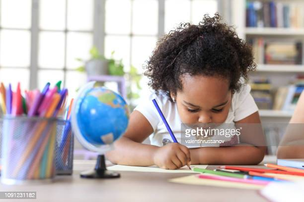 little girl drawing at home - coloring stock pictures, royalty-free photos & images