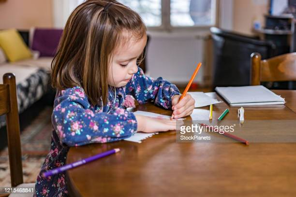 little girl drawing at home - one girl only stock pictures, royalty-free photos & images