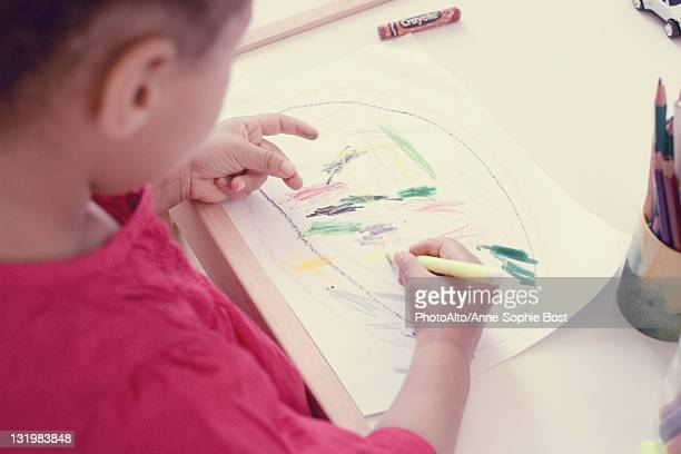 Little girl drawing, high angle view