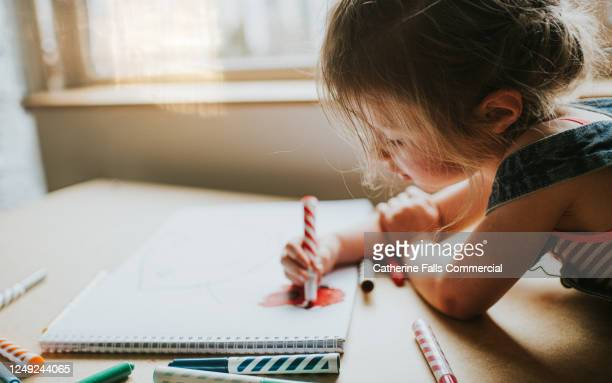 little girl drawing in a big sketch book with felt tips - one girl only stock pictures, royalty-free photos & images