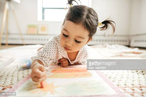 little girl drawing with crayon - cute stock pictures, royalty-free photos & images