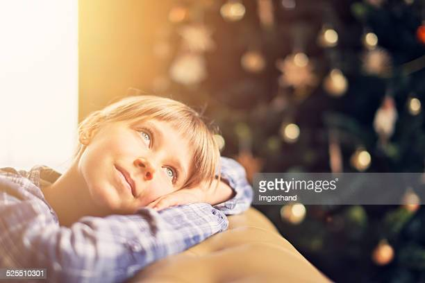 Little girl dreaming about christmas